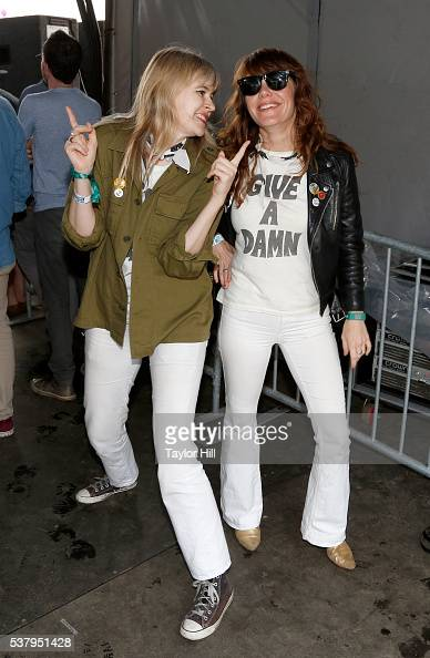 Tennessee Thomas and Jenny Lewis pose backstage at the 2016 Governors Ball Music Festival at Randall's Island on June 3 2016 in New York City