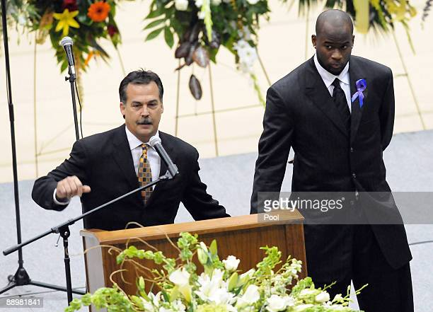 Tennessee Titans coach Jeff Fisher left and Titans quarterback Vince Young make remarks during a funeral service for former NFL quarterback Steve...