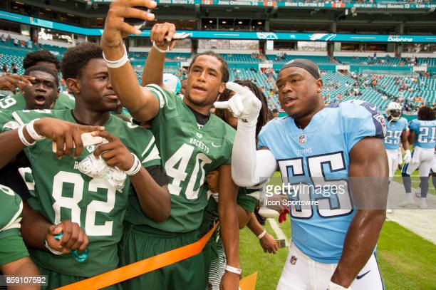 Tennessee Titans Linebacker Jayon Brown poses for a selfie with players from the Miami Central High school football team on the sidelines before an...