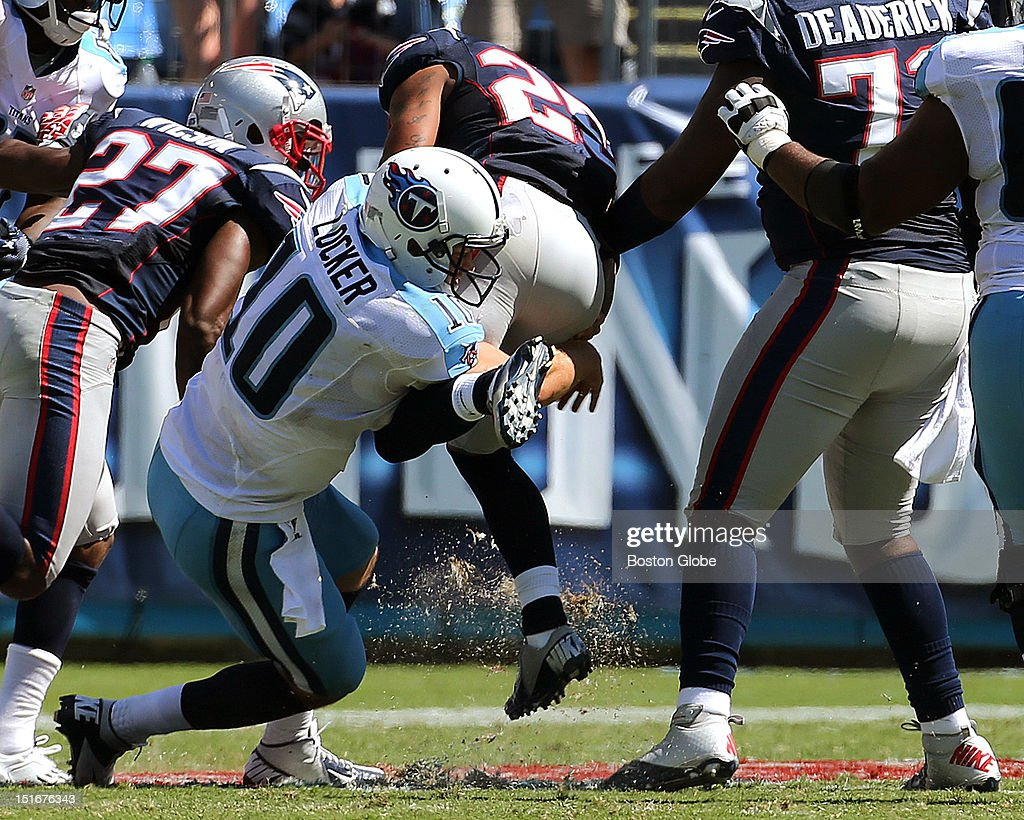 Tennessee Titans quarterback Jake Locker (#10) tackles New England Patriots free safety Patrick Chung (#25) on a play that caused an injury to Locker, who left the game, during the New England Patriots season opener against the Tennessee Titans at LP Field in Nashville.