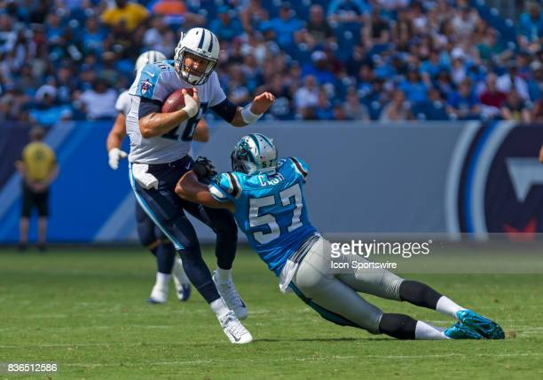 Tennessee Titans quarterback Matt Cassel breaks a tackle from Carolina Panthers linebacker Jeremy Cash during the preseason NFL game between the...