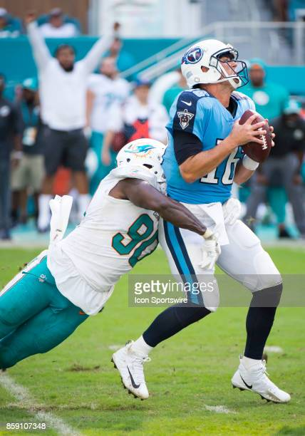 Tennessee Titans Quarterback Matt Cassel is sacked by Miami Dolphins Defensive End Charles Harris during an NFL game between the Tennessee Titans and...