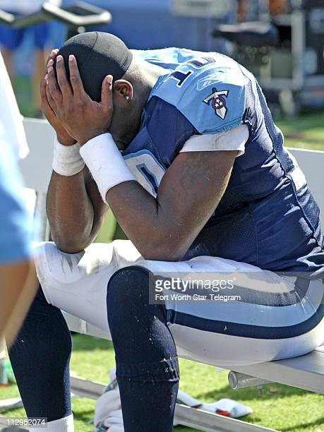Tennessee Titans quarterback Vince Young hangs his head after giving up a fourth quarter fumble to the Dallas Cowboys at LP Field in Nashville...