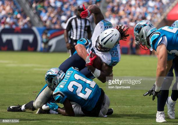 Tennessee Titans running back Derrick Henry is tackled at the line of scrimmage during the preseason NFL game between the Tennessee Titans and...