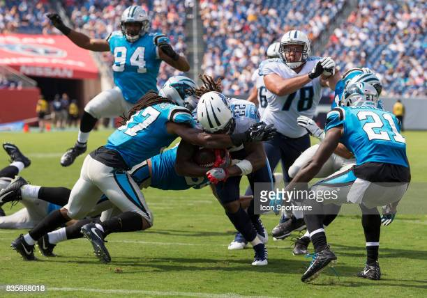 Tennessee Titans running back Derrick Henry tries to break though the defense near the endzone during the preseason NFL game between the Tennessee...
