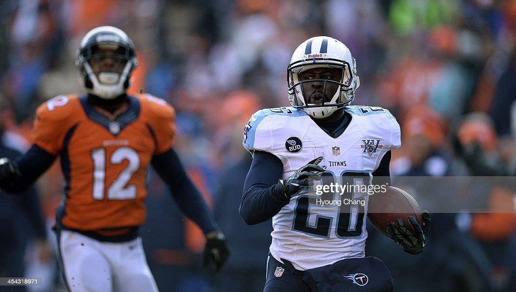 Tennessee Titans running back Leon Washington makes a 98 yard return during the first quarter while Denver Broncos wide receiver Andre Caldwell...
