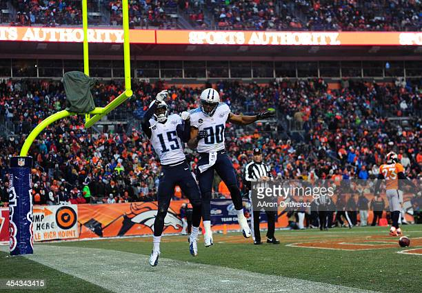 Tennessee Titans wide receiver Justin Hunter and Tennessee Titans tight end Visanthe Shiancoe celebrate a touchdown in the third quarter The Denver...