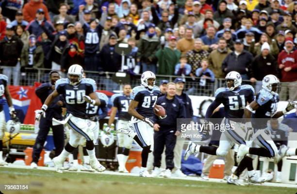 Tennessee Titans wide receiver Kevin Dyson takes a kickoff return 75 yards for a touchdown during the AFC Wildcard Playoff a 2216 victory over the...