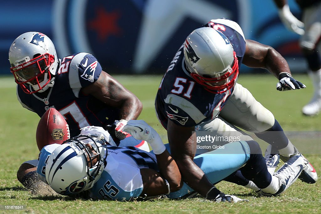 Tennessee Titans wide receiver Nate Washington (#85) fumbles the ball after it appeared he had made a pass reception before he was hit by New England Patriots free safety Tavon Wilson (#27) and New England Patriots free safety Patrick Chung (#25), who recovered the fumble and ran it back, during the fourth quarter of the New England Patriots season opener against the Tennessee Titans at LP Field in Nashville. A review by officials called it an incomplete pass on the play. Washington was also injured on the play.