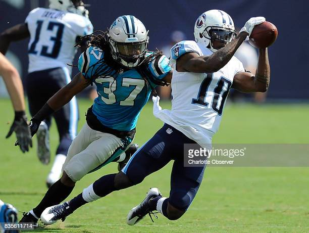 Tennessee Titans wide receiver Rishard Matthews makes a reception in front of Carolina Panthers defensive back Dezmen Southward during the first half...
