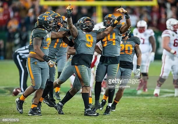 Tennessee Volunteers defensive end Derek Barnett celebrates with teammates linebacker Darrin Kirkland Jr defensive lineman Kendal Vickers linebacker...