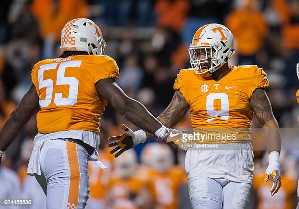 Tennessee Volunteers defensive lineman Quay Picou and Tennessee Volunteers defensive end Derek Barnett celebrate during a game between the Missouri...