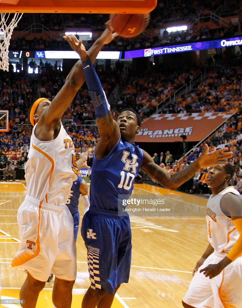 Tennessee Volunteers forward Jarnell Stokes (5) blocks a shot by Kentucky Wildcats guard Archie Goodwin (10) during game action at Thompson-Boling Arena in Knoxville, Tennessee, Saturday, February 16, 2013. Tennessee defeated Kentucky, 88-58.