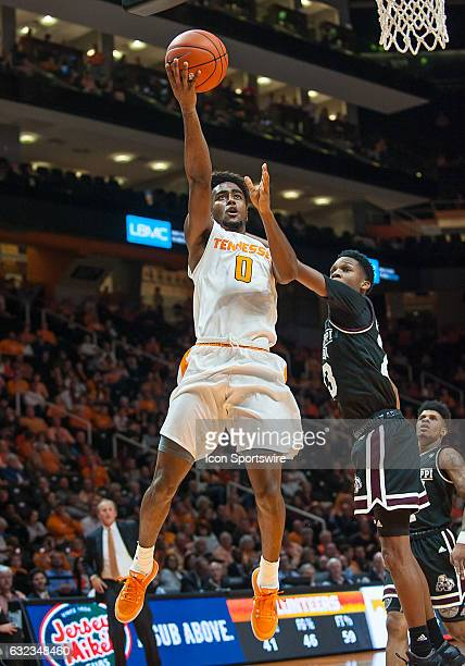 Tennessee Volunteers guard Jordan Bone drives past Mississippi State Bulldogs guard Tyson Carter for a shot during a game between the Mississippi...