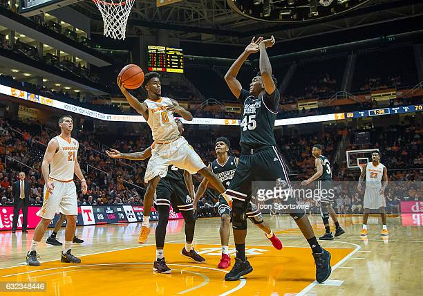 Tennessee Volunteers guard Jordan Bone passes the ball back outside around Mississippi State Bulldogs center EJ Datcher during a game between the...
