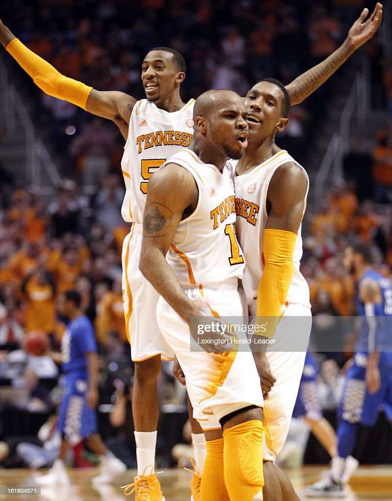 Tennessee Volunteers guard Trae Golden (11) celebrated with teammate Josh Richardson (1) after nailing a three-pointer against Kentucky at Thompson-Boling Arena in Knoxville, Tennessee, Saturday, February 16, 2013. Tennessee defeated Kentucky, 88-58.