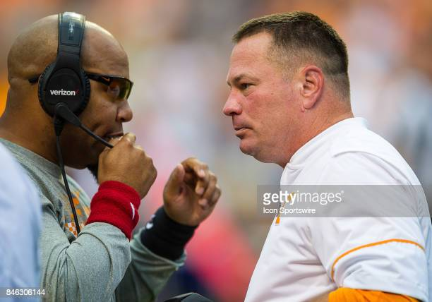 Tennessee Volunteers head coach Butch Jones talks with assistant head coach and running backs coach Robert Gillespie during a game between the...