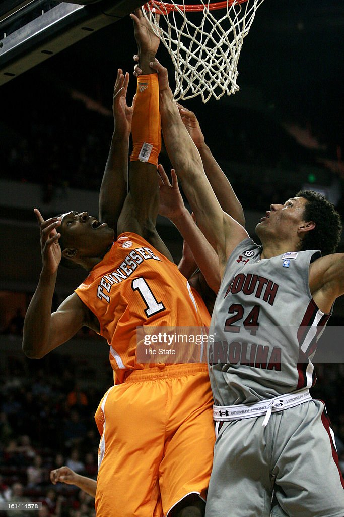 Tennessee Volunteers Josh Richardson and South Carolina Gamecocks Michael Carrera battle for a rebound during first-half action at the Colonial Life Arena in Columbia, South Carolina, Sunday, February 10, 2013.