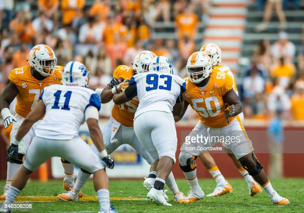 Tennessee Volunteers offensive lineman Venzell Boulware offensive lineman Jashon Robertson and offensive lineman Trey Smith blocking during a game...