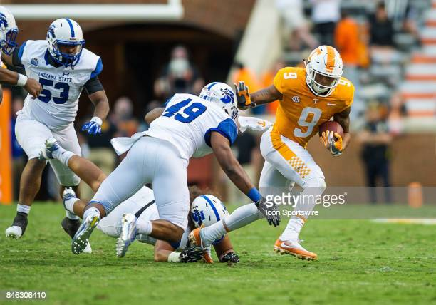 Tennessee Volunteers running back Tim Jordan runs away from Indiana State Sycamores linebacker Antonio Broadus during a game between the Indiana...