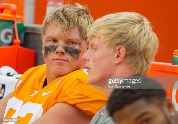 Tennessee Volunteers tight end Ethan Wolf talks with his injured brother tight end Eli Wolf during a game between the Indiana State Sycamores and...