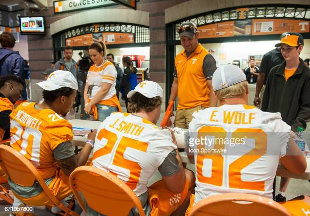 Tennessee Volunteers tight end Ethan Wolf wide receiver Josh Smith and linebacker Cortez McDowell sign autographs for fans before Tennessee's Orange...