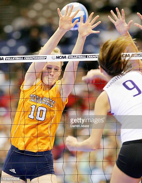 Tennessee's Kristen Andre attempts to block a spike from Washington's Christal Morrison during the NCAA Division I women's volleyball semifinal match...