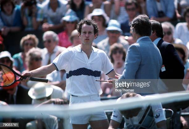 Tennis 1985 Wimbledon Championships John McEnroe of the USA contests a decision with referee Alan Mills