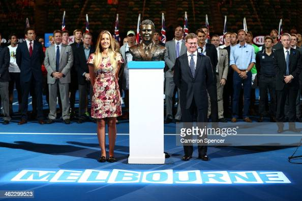 Tennis Australia President Steve Healy and Ally Drewett unveil a bust of her father Brad Drewett during day one of the 2014 Australian Open at...