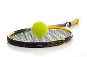 A new tennis ball and racket on a white background with copy space