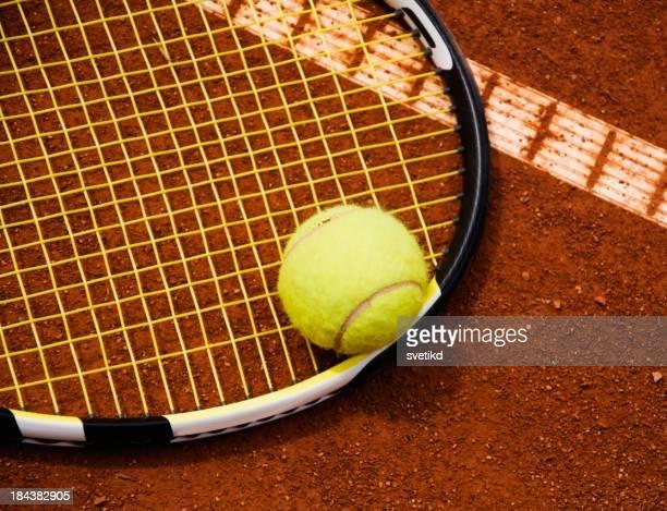 Tennis ball and racket.