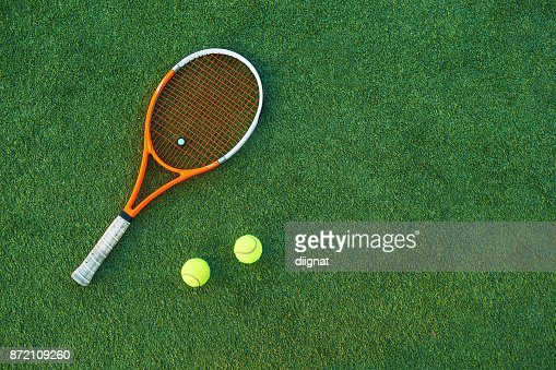 Tennis ball and rackets on grass : Stock Photo