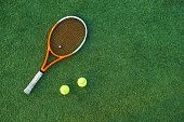 Tennis ball and rackets on tennis court. Equipment for playing tennis on grass.  Close-up tennis rackets. Copy space available