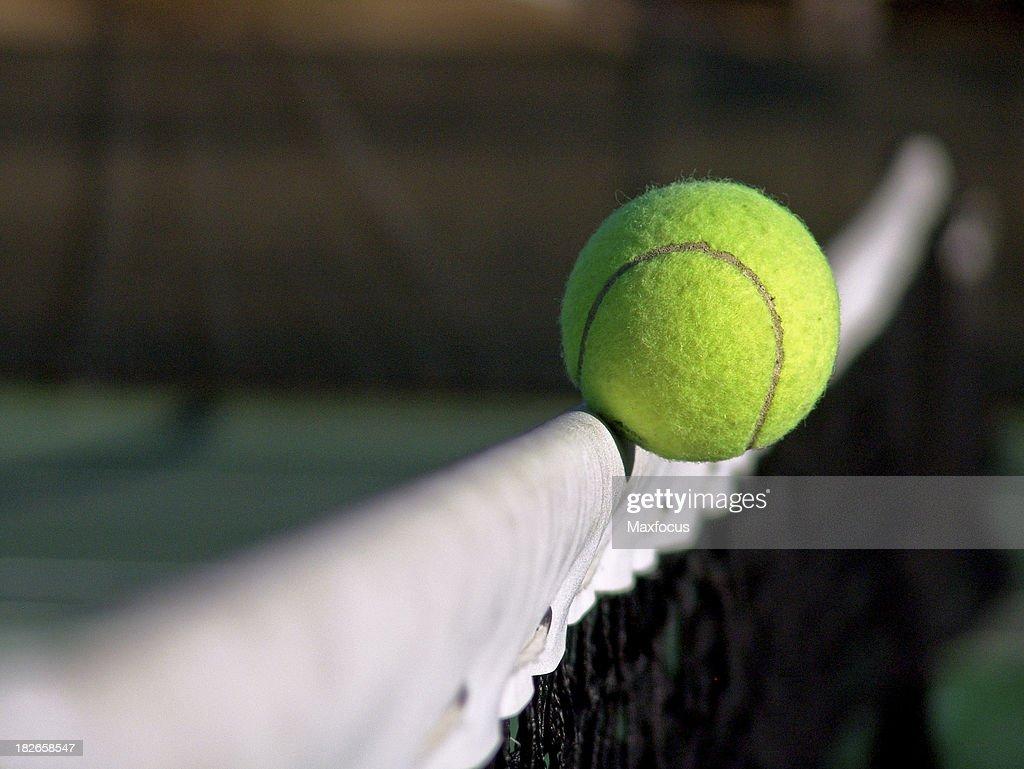 Tennis Ball Crosses the Net : Stock Photo