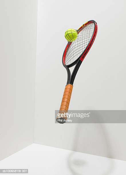 Tennis ball into racket netting