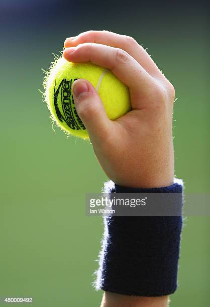 A tennis ball is held by a ball boy during day nine of the Wimbledon Lawn Tennis Championships at the All England Lawn Tennis and Croquet Club on...