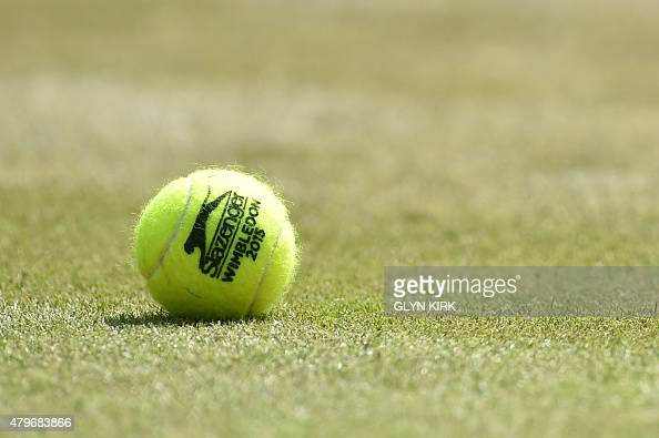 A tennis ball lies on No 1 court before Switzerland's Stan Wawrinka plays against Belgium's David Goffin during their men's singles fourth round...