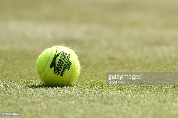 A tennis ball lies on No 1 court before Switzerland's Stan Wawrinka plays against Belgium's David Goffin during their men's singles fourth round...