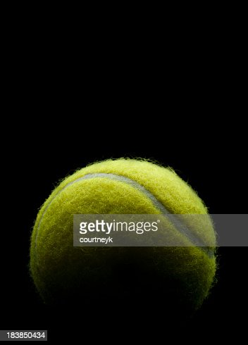 Tennis ball on a black background