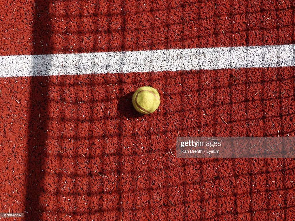 Tennis Ball On Clay Court : Photo