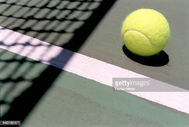Tennis ball on court AFR picture by JESSICA SHAPIRO