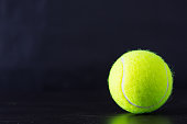 tennis ball with black background.