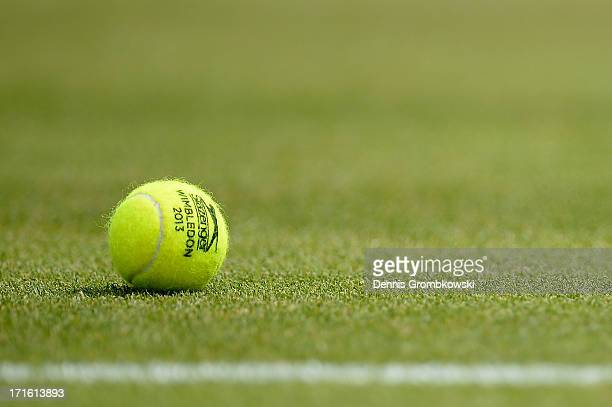A tennis ball rests on the turf during the Ladies' Singles second round match between Petra Martic of Croatia and Karolina Pliskova of Czech Republic...