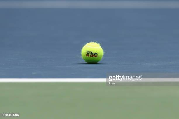 A tennis ball sits on the court during the Men's Singles finals match between Kevin Anderson of South Africa and Rafael Nadal of Spain on Day...