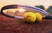 Tennis game. Tennis ball with racket on the tennis court. Sport, recreation concept