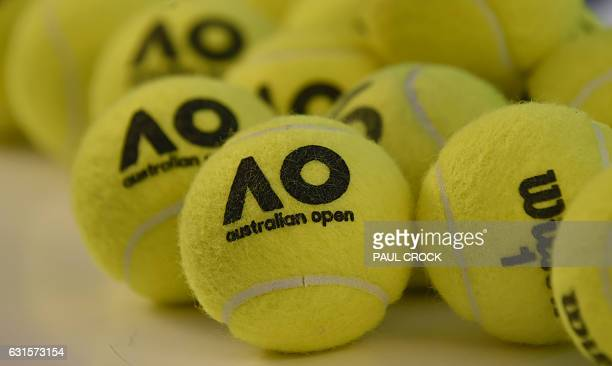 Tennis balls carrying the new livery lie on the ready ahead of the Australian Open tennis tournament in Melbourne on January 13 2017 / AFP / PAUL...