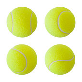 Collection of four tennis balls isolated on pure white background