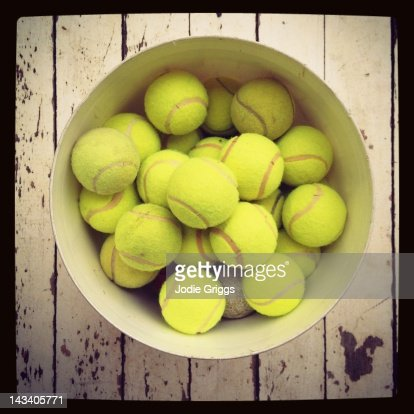 Tennis balls in bucket