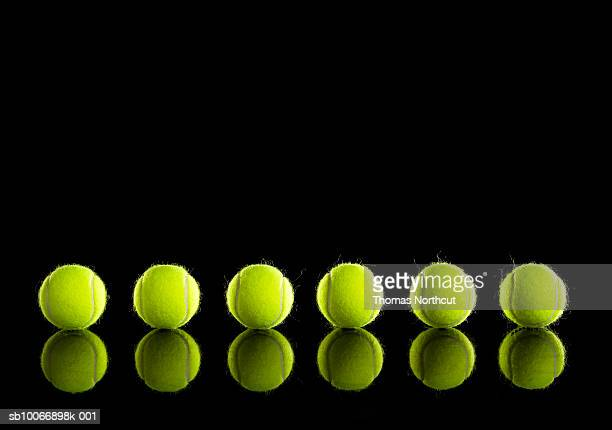 Tennis balls in row