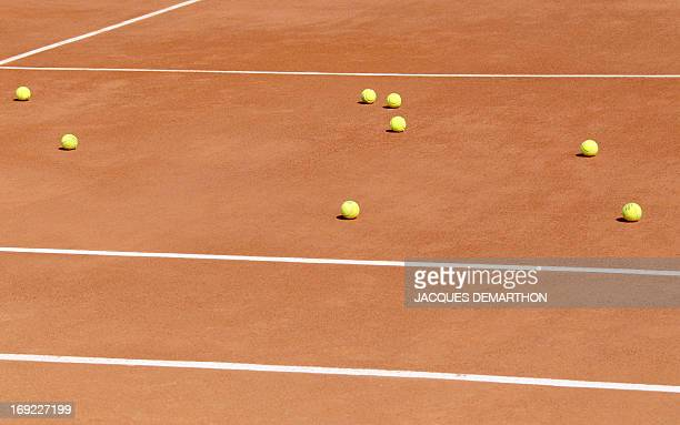 Tennis balls lay on the clay court during a training at RolandGarros tennis stadium in Paris on May 20 three days ahead of the French Open the second...